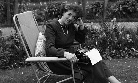 Blyton in her garden with her typewriter.