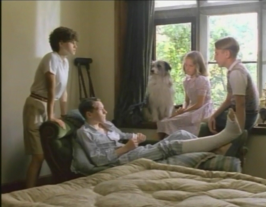 Screen shot of the 1990s Famous Five TV series, showing Marco Williamson with a broken leg. (L-R) Jemima Rooper, Marco Williamson, Connal, Laura Petela, Paul Child.