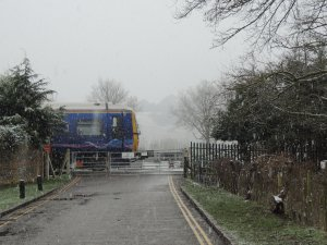 The Train passing the level crossing as we drew closer.
