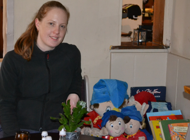 Corinna at the Red Lion Pub with their Blyton stash.