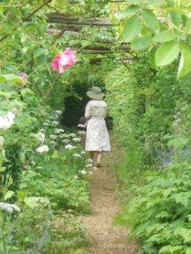 A Japenese tourist in the rose pergola