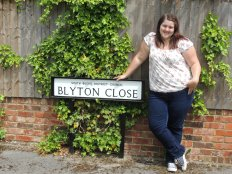 Me by the sign at Blyton Close.
