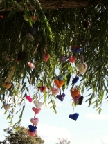 Knitted hearts hanging from a willow tree