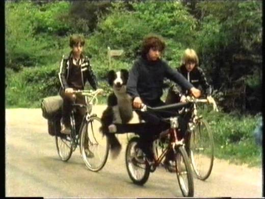 Dick (Gary Russell), Timmy (Toddy), George (Michele Gallagher) and Richard Kent (Grant Bardsley) on their bikes in Five Get Into Trouble.